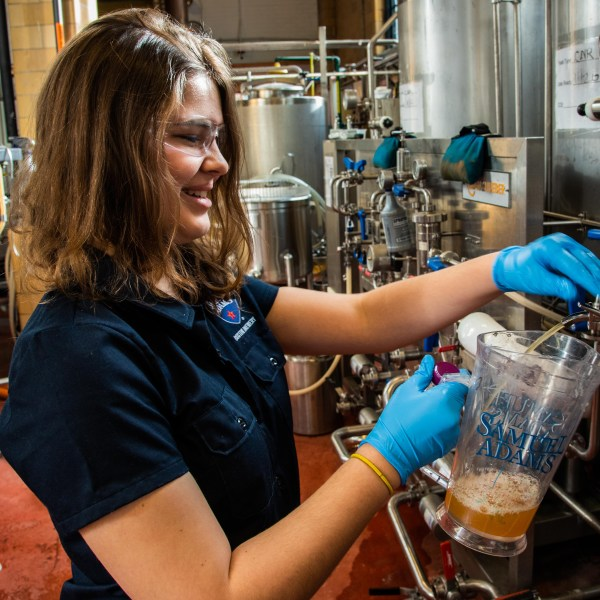 Elizabeth Curtis, Biology '19, pours a pint of lager at the Boston Beer Company in Jamaica Plain. Photo by Tim Briggs