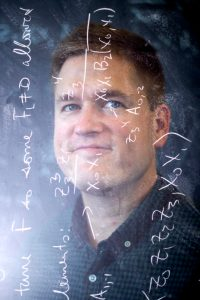 7/22/19 - BOSTON, MA. - James Halverson Assistant Professor of Physics poses for a portrait on July 22, 2019. Photo by Matthew Modoono/Northeastern University