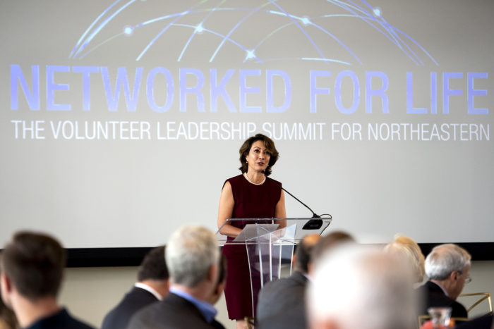 Senior Vice President for University Advancement Diane MacGillivray recognizes volunteers during the Network for Life event in the East Village. Photo by Ruby Wallau/Northeastern University