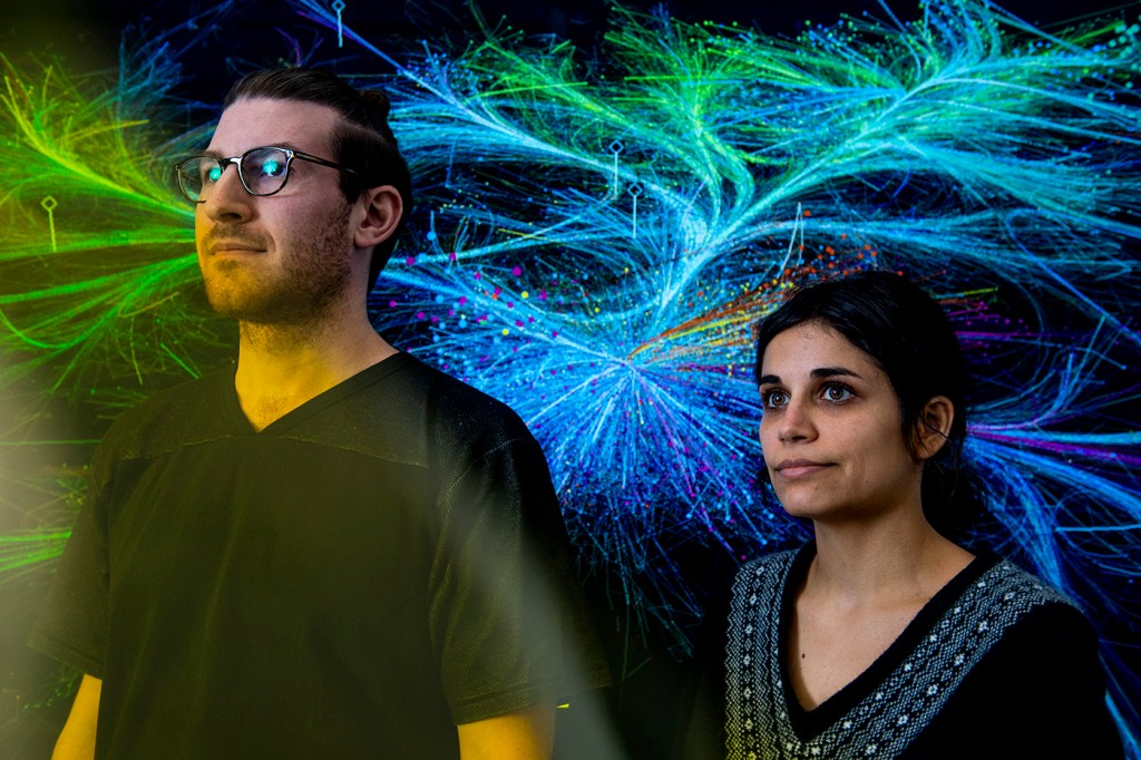 11/12/19 - BOSTON, MA. - Doctoral students Alex Gates and Alice Grishchenko pose for a portrait at the The Network Science Institute on on Nov. 12, 2019. Both were the leaders on a project which analyzed, organized and visualized 150 years of scientific articles by the British journal Nature. Photo by Matthew Modoono/Northeastern University