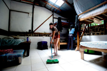 Catalina Aycardi, left, and Shivani Ananth clean their room during afternoon break. Interns share the dorm room during the stay at VerdEnergia.