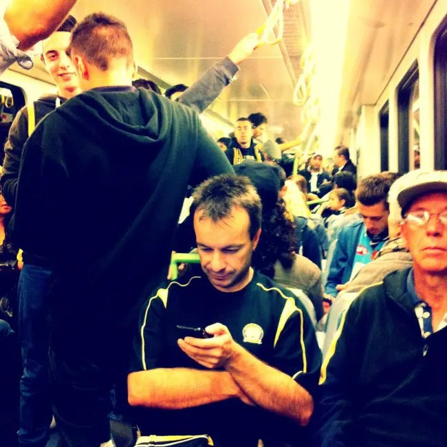 On the train headed to the footy game.