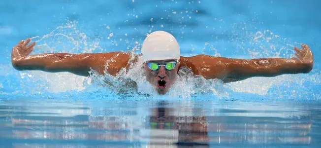 Ryan Lochte swims in the men's 400-meter individual medley preliminaries at the U.S. Olympic swimming trials.