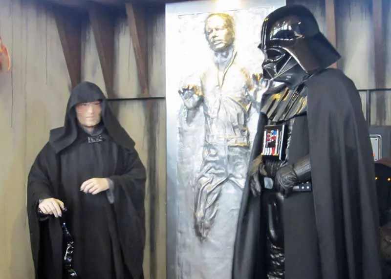 Emperor Palpatine and Darth Vader with poor Han Solo frozen in carbonite.