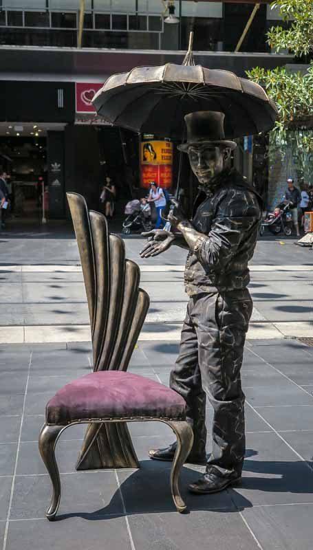 Man as statue.