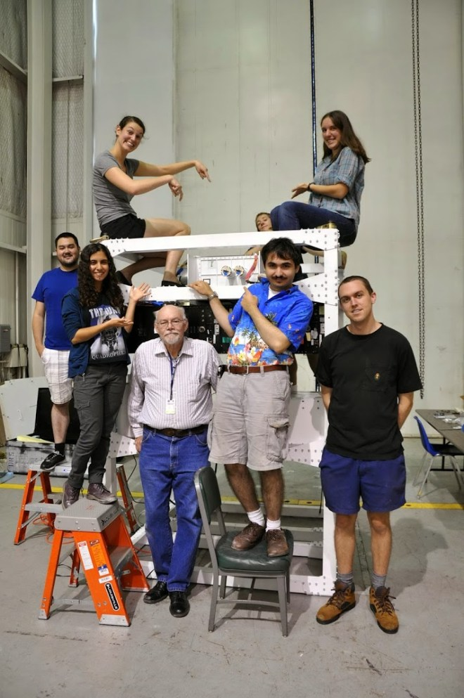 After a couple hiccups, we finally got the cryostat onto the gondola where it belongs. Here's the happy and accomplished team.