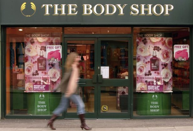 LONDON - MARCH 17: A woman walks past The Body Shop store window on March 17, 2006 in London, England. Beauty products retailer Body Shop have announced that they be taken over by French cosmetics company L'Oreal in a deal worth GBP652m. (Photo by Scott Barbour/Getty Images)