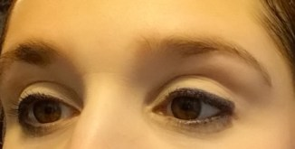 Bobbi Brown Natural Brow Shaper & Hair Touch Up - Brunette No. 7 - swatched on brow on left side with bare brow on the right