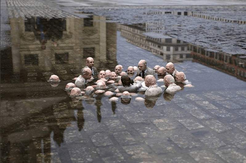 "This sculpture by Isaac Cordal in Berlin is called ""Politicians discussing global warming."""