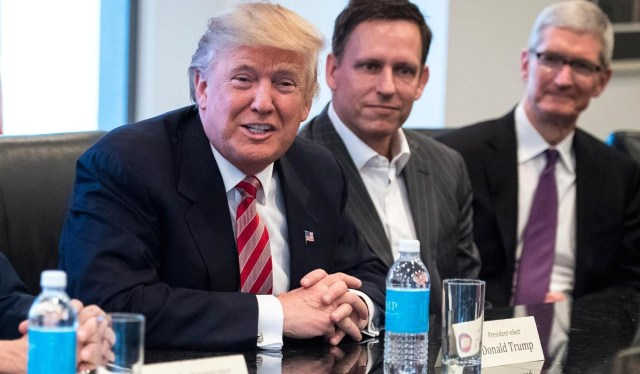 Donald Trump met with tech industry leaders including venture capitalist Peter Thiel and Apple CEO Tim Cook last month. (Pool via YouTube)