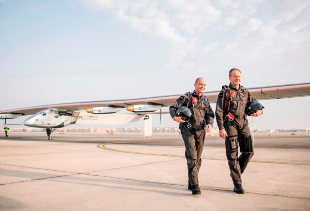 Solar Impulse pilots and plane