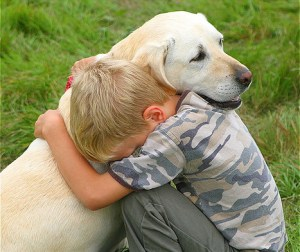 Young Boy Hugging Dog