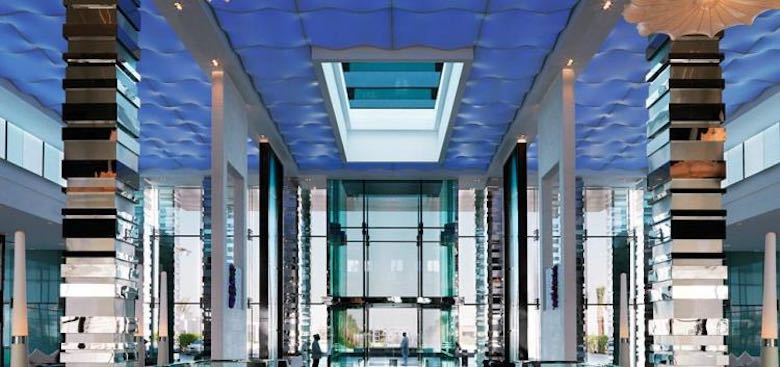 The silver accents of the grand lobby of the Fairmont Bab Al Bahr hotel in Abu Dhabi, showing perfect symmetry