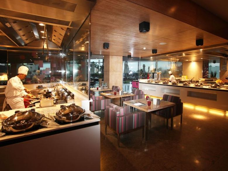 Cooks of the Fairmont Bab Al Bahr hotel in Abu Dhabi cooking food in the open kitchens in the restaurant