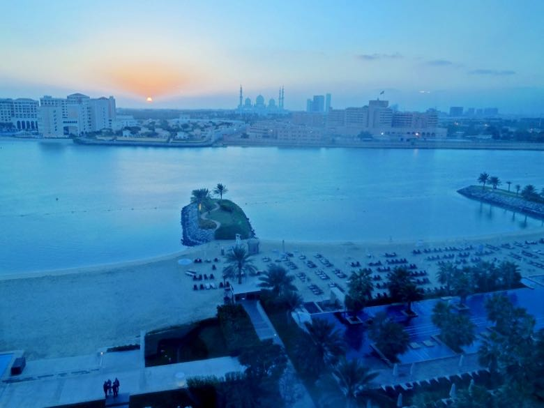 The view from our room at the Fairmont Bab Al Bahr hotel in Abu Dhabi during the blue hour, showing the bay and the Sheikh Zayed Grand Mosque in the distance