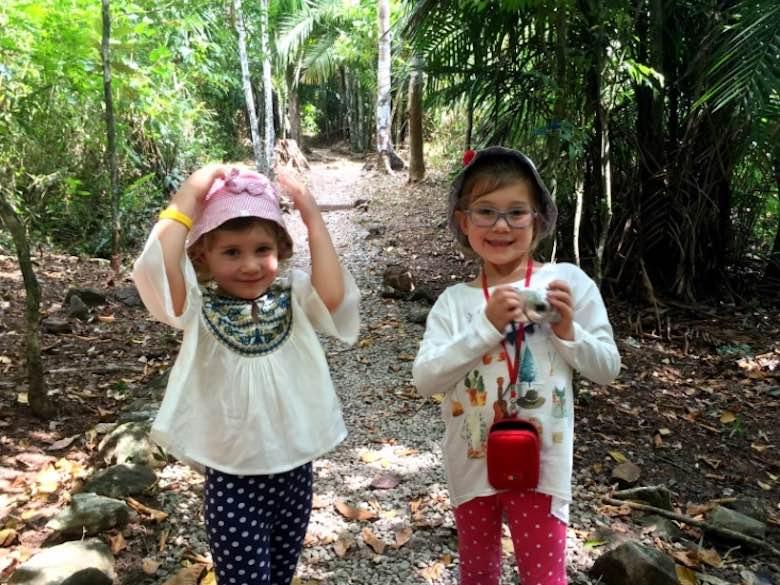 Two kids exploring Panama's Parque Metropolitano