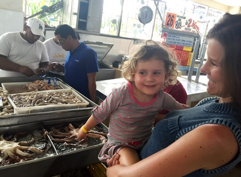 CosmopoliClan mom and daughter Jade admiring the octopus for sale in the Mercado de Mariscos in Panama
