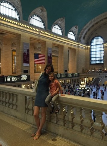 Mother and daughter posing on a balcony in Union Station in NYC