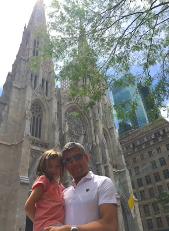 Father and daughter posing in front of St-Patrick's Cathedral in Manhattan during our NYC family adventure