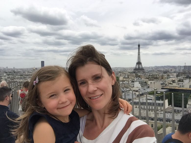 Mother and daughter on the top of the Arc de Triomphe in Paris