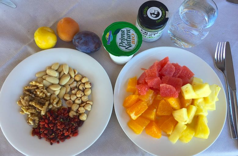 Healthy breakfast at Palazzo di Varignana Resort & Spa near Bologna, with fruits, nuts, goji berries and yoghurt