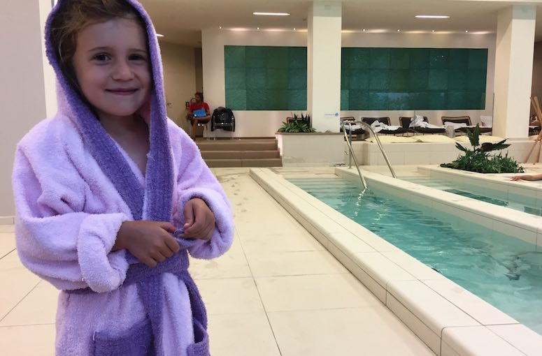 Little Jade in a purple bathrobe at the VarSana spa, part of the Palazzo di Varignana Resort & Spa near Bologna