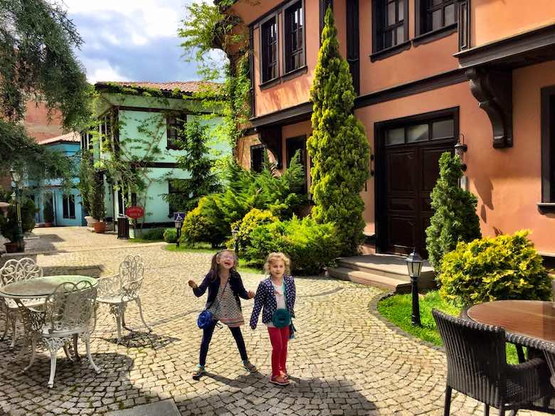 Two sisters giggling while exploring the Abaci Konak hotel in colorful Odunpazarı, the historic district of Turkish Eskişehir
