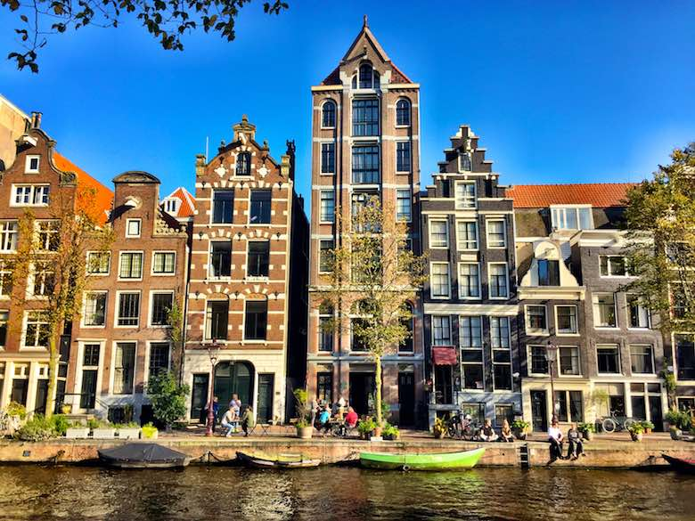 Lovely narrow and bending houses along the canal in Amsterdam