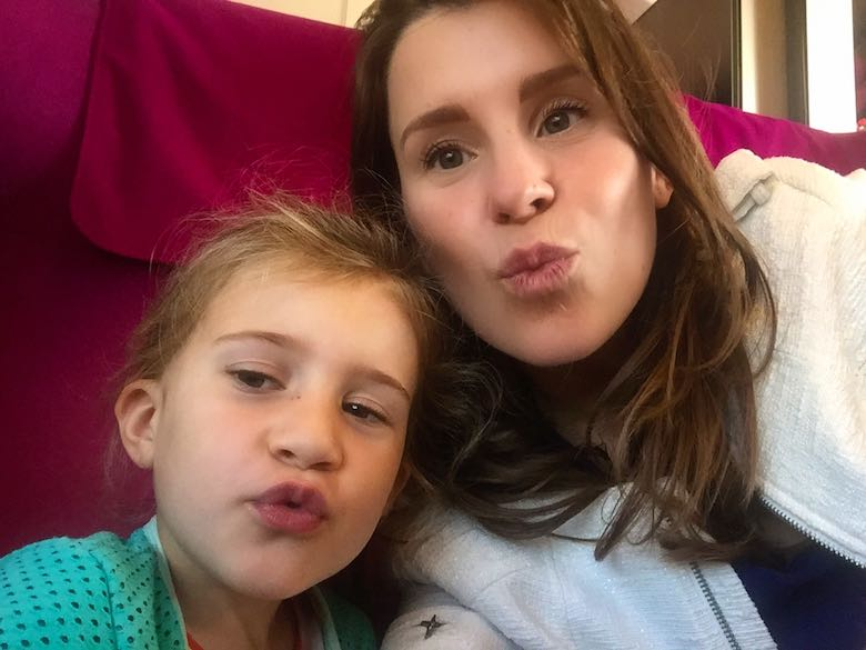 Mother and daughter giving a kiss to the camera for a selfie from within the Thalys train to Amsterdam