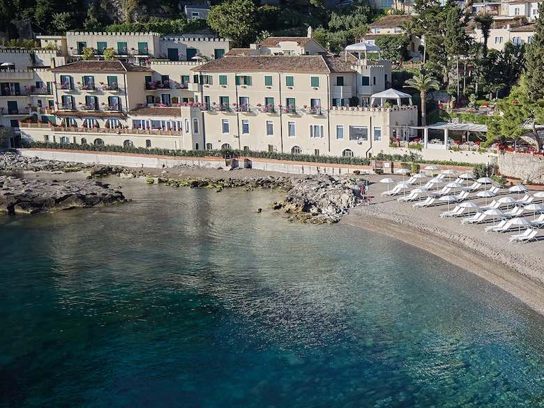 Aerial view of Belmond Villa Sant'Andrea in Sicily, Italy, featured in this article with family-friendly luxury resorts in the Mediterranean