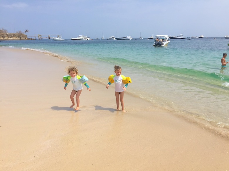 Two sisters in rashguard at the beach of Isla Contadora, the ultimate one-day beach getaway from Panama City