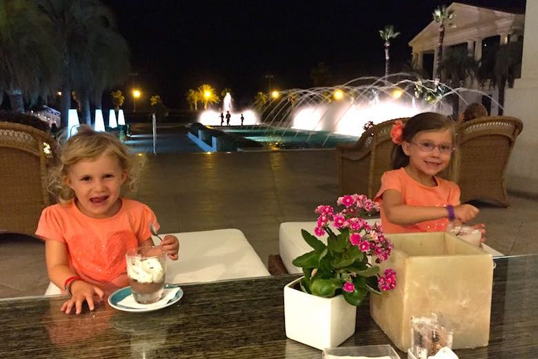 Our CosmopoliGirls enjoying a desert at Hotel Balneario Las Arenas, one of 10 exquisite family-friendly luxury hotels in Spain