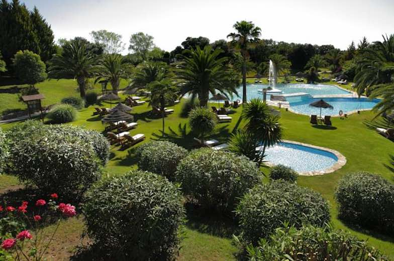Garden and pool at La Bobadilla, one of 10 exquisite family-friendly luxury hotels in Spain