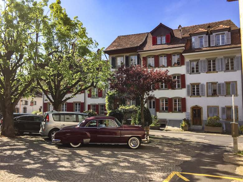 Classic car on the charming town square in medieval Murten