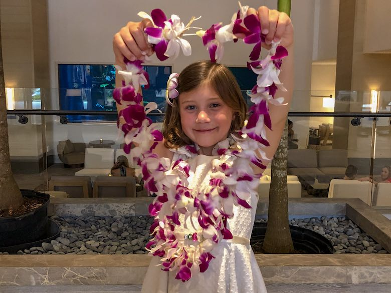 Little girl showing the lei she made herself at the Alohilani Resort in Waikiki Beach