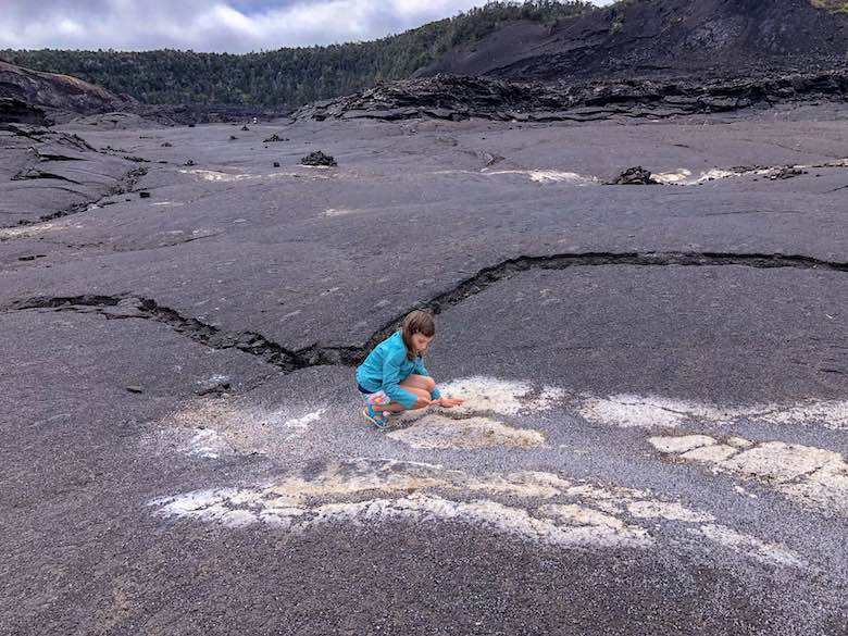 Little girl feeling the warmth on the crater floor during a hike of the Kilauea Iki trail in Volcanoes National Park