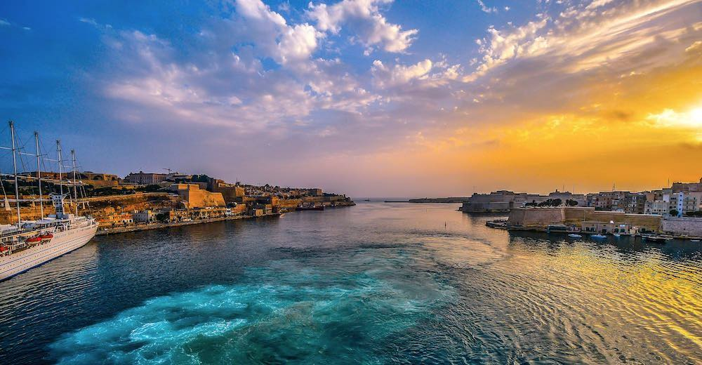 Colorful sunset over Malta's Grand Harbour