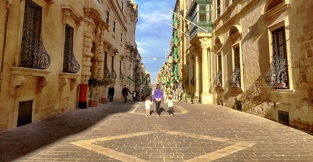 Mother and 2 kids walking the streets of Valletta, one of the best places to visit in Malta