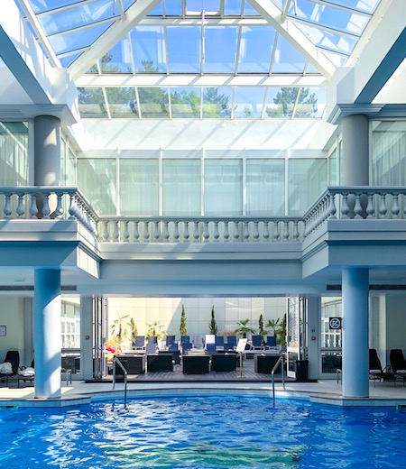 The indoor pool of the Deluxe Palace Family Room with garden view at the Trianon Palace Versailles, a Waldorf Astoria hotel