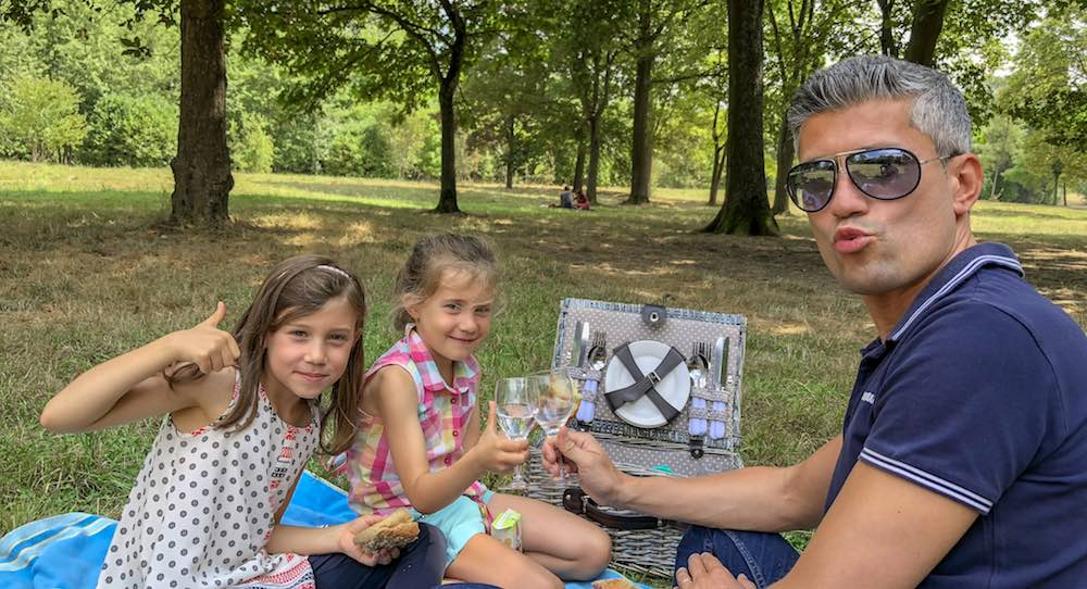 Having a picnic at one of the designated picnic areas while visiting Versailles