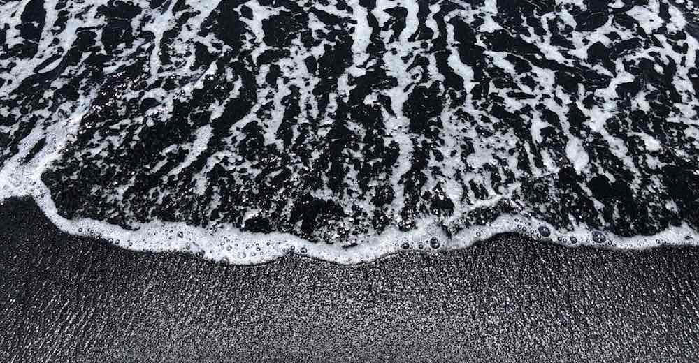Sparkling black sand beach on Hawaii Big Island