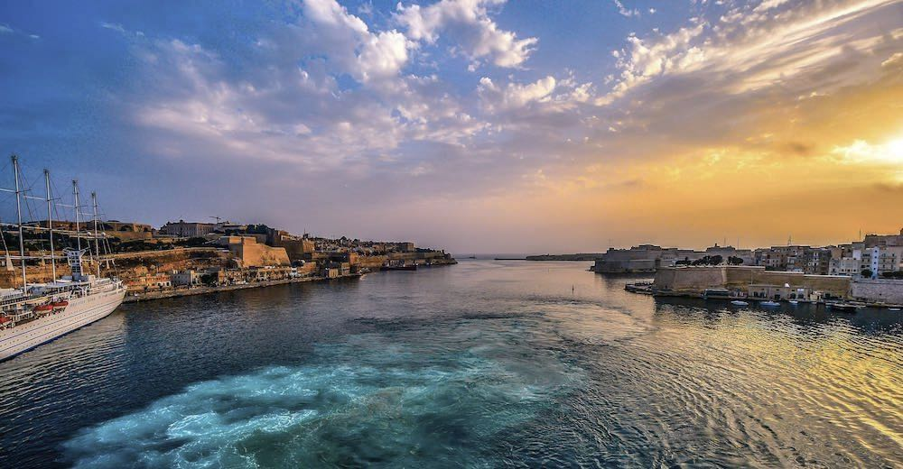 A beautiful sunset over the Grand Harbour, one of the best things to visit in Malta