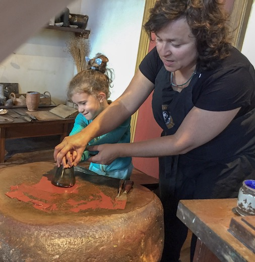 Little girls preparing the paint the Rembrandt way at the Rembrandt House Museum, an Amsterdam must do