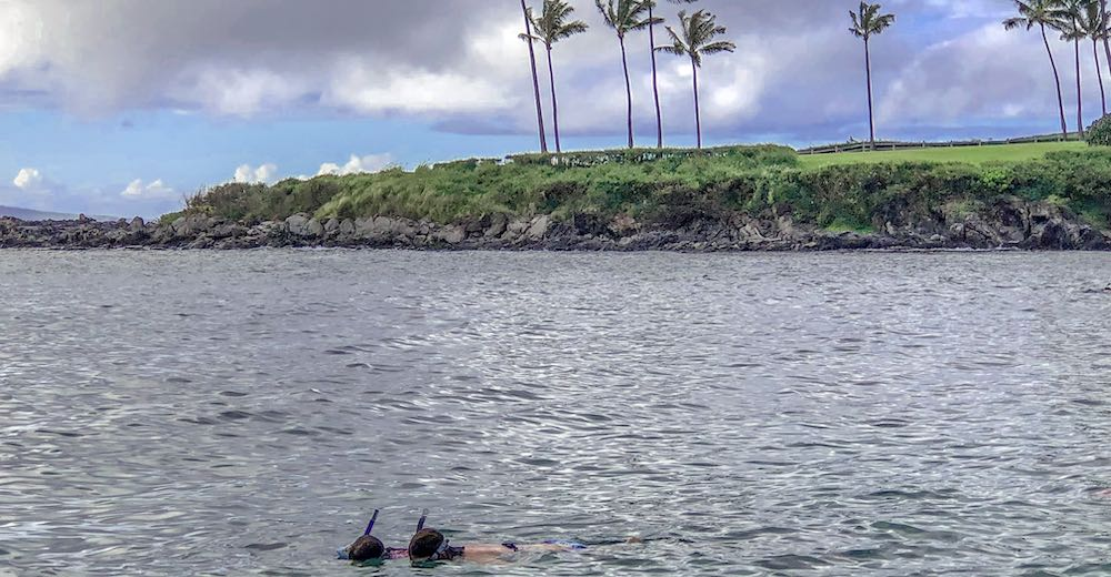 Mother and daughter snorkeling in Kapalua Bay, one of the best things to do with kids in Maui