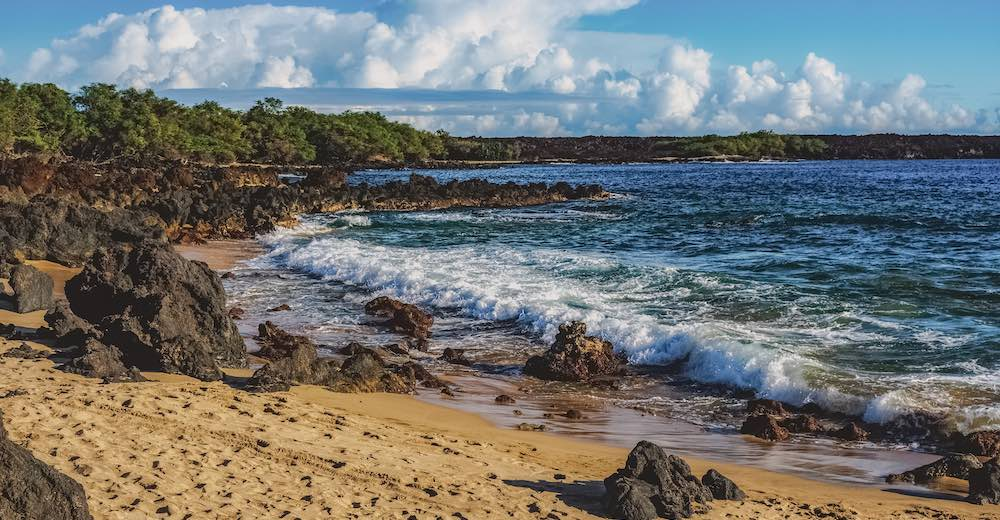 La Perouse Bay forms the stunning location for the Hoapili Trail, a challenging coastal hike on the Valley Isle