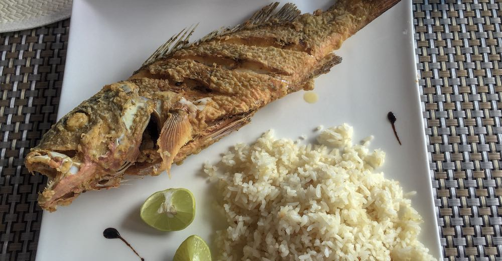 Grilled fish, rice and lemon on a plate at a hotel restaurant in Contadora Island, Panama