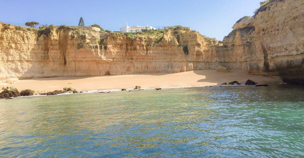 View from the water over Praia da Ponta Grande, a hidden beach in Portugal