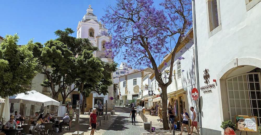 Picturesque street in historic Lagos, Portugal, and a view of the Igreja de Santo António (church), a Lagos must-see