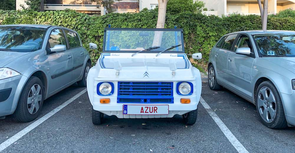 Cute little convertible car on a parking in Cassis France