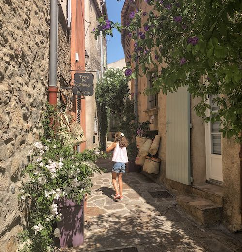 Little girl wandering the streets of Bormes-les-Mimosas in France
